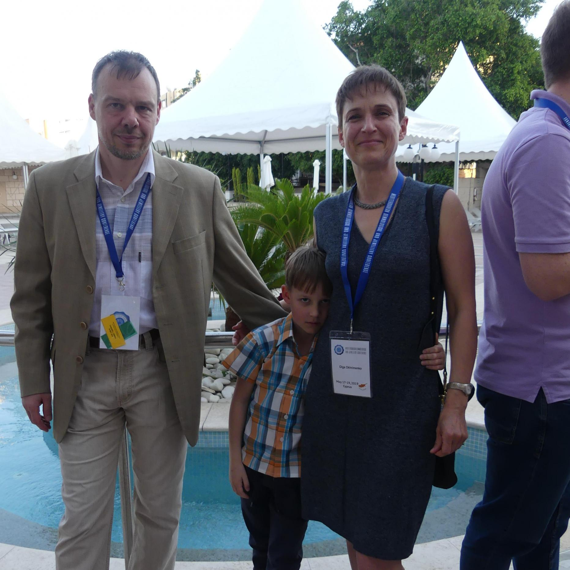 Sergey, son and Olga at cocktail reception