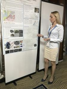 Svetlana Kultenko in front of Poster on Corundums from the Jewish Autonomous Region in Russia