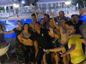 Group photo of participants jumped into pool