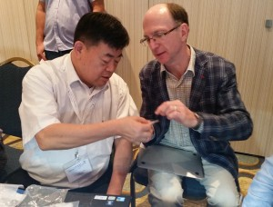 Joe Yuan showing synthetic diamonds with John Chapman